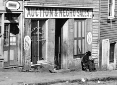 A black Union Soldier outside a slave auction house in Georgia
