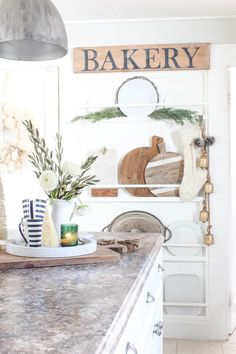 I love this wall with shelf/racks for cutting boards and platters. Christmas in the Kitchen 2017 | Rooms FOR Rent Blog