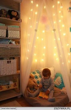 This cozy reading nook can be created in any small kid's room.