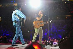 "Musicians Kenny Chesney (R) performs ""Ocean Front Property"" and ""The Fireman"" with George Strait (L) onstage at George Strait's 'The Cowboy Rides Away Tour' final stop at AT"