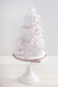 Phoenix Sweets cherry blossom wedding cake in pale pink with delicate sugar cherry blossom!!sweet!