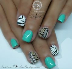 turqouis cheetah and zebra acrylic nails with gems
