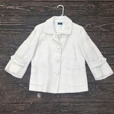 J. Crew cream lightweight jacket Woven lightweight jacket. Beautiful cream color. Mid length, 3/4 length sleeves. 4 fabric buttons down the front, 2 small straps with buttons near the end of the sleeves. They don't adjust, just a fun detail. J. Crew Jackets & Coats