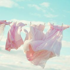 ❥ pink dresses blowing in the breeze against an aqua blue sky