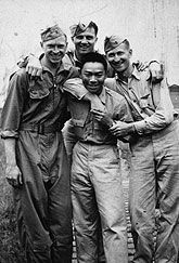 "1ST LT. FRED GONG (CENTER), LEAD BOMBADIER ON B-17 FLYING FORTRESS DURING WWII  While Pearl Harbor cast suspicion on Japanese Americans, it resulted in a more positive attitude about Chinese Americans. Suddenly, China was America's ally and Chinese Americans became the ""good Asians."" As patriotic fever swept through the country, thousands of Chinese American men enlisted.  Credit: Chinese Historical Society of Southern California"