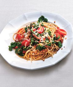 """Whole-Grain Spaghetti With Garlicky Kale and Tomatoes   Real Simple Recipes    Kale is being called """"the new beef"""", """"the queen of greens"""" and """"a nutritional powerhouse.""""    http://www.realsimple.com/food-recipes/browse-all-recipes/whole-grain-spaghetti-with-garlicky-kale-and-tomatoes-00000000051131/index.html"""