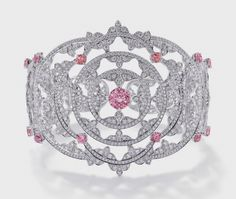 """Jewelry News Network: British Firm Mappin & Webb Reinvents Itself with New Creative Director and Jewelry Collection - The motif of this elaborate 18k white gold cuff from the """"Empress"""" collection is repeated in concentric circles set with 6.15 carats of diamonds and 5.84 carats of round-cut pink gems."""