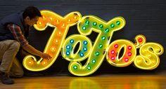 Jojo's - Yellow neon & fairground lights by Goodwin & Goodwin