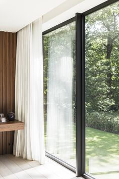 In this large family house they've combined sharp lines with a warm, limited material palette: walnut veneer, oak, natural stone, a few luxurious touches of travertine and beautiful aluminium windows Picture by Annick Vernimmen Curtains For Bifold Doors, Curtains With Blinds, Interior Ceiling Design, Interior Design Tips, Living Room Modern, Living Room Decor, Aluminium Windows And Doors, Ceiling Curtains, Doors And Floors
