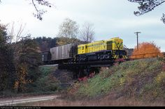 A northbound freight train was passing over a country road near Springfield, WV on Oct. 20, 1980 with MRS-1 No. 28.