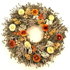 Strawflower Wreath -$80 The pale yellows, warm oranges and soft greens in this delicate wreath recall the colors of early fall. Artisans at a California flower and herb farm create the arrangement by mingling fragrant summer savory, marjoram and sage with delicate German statice and sinuate statice. Air-dried strawflowers and globe amaranth add gentle bursts of color.