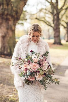 An Autumn look for a bride in (faux) fur - peach, pink, creams and greens. Jacquline and Henry's Hackney East London elopement. https://www.babbphoto.com/hackney-town-hall-elopement-photography/