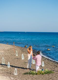 This beach proposal in Santorini is so beautiful, and the full video has us sobbing!