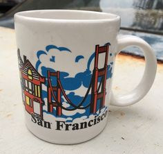 This is a listing for the San Francisco MUNI Mug. Great retro mug depicting the Golden Gate Bridge and the MUNI Powell & Hyde st. Cute little design with small colorful houses. Great conversation starter office mug. Heavy, high quality mug. Ceramic Bright and geometric style. As always&#x3b; view all photos closely and ask all questions before hitting the buy it now. If you enjoyed this item, check out my other listings and follow me as a seller for more like this in the future&am...