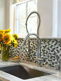 Update your kitchen with a unique backsplash. More kitchen backsplash ideas: http://www.bhg.com/kitchen/backsplash/kitchen-tile-backsplash-ideas/?socsrc=bhgpin122913roundtiles&page=10