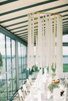 Suspended ribbon centerpieces   Classic Chic Swedish Summer Archipelago Wedding At Dalarö Skans   Photograph by 2 Brides Photography  http://storyboardwedding.com/classic-chic-swedish-summer-archipelago-wedding-dalaro-skans/