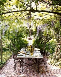 outdoor dining room - patio - terrace - backyard patio design - garden design - interior design and decor - flower canopy - purgola  via pinterest