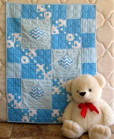 Gone Fishing - a handmade baby quilt for boys that is a wonderful combination of patchwork quilting and applique.  SEW perfect for the little fisherman in any family.