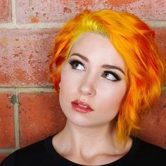 Vibrant Yellow Go Deep oVertone over her bleach-washed Extreme Orange.