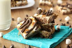 Chewy chocolate chip cookie bars topped with toasted marshmallows and chocolate drizzle that are easy to whip up when you need a special treat.