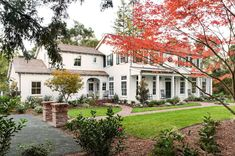 Southern sensibilities inspired the design of this colonial revival farmhouse by Tim Barber Architects, located in Atherton, California. Southern Architecture, Residential Architecture, Tim Barber, Green Shutters, Colonial Style Homes, Dutch Colonial, Modern Colonial, Spanish Colonial, Farmhouse Front