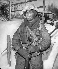 Grizzled American soldier geared for winter combat