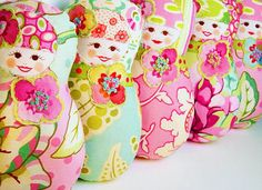 Cloth Russian matryoshka dolls.  I just love their shape and they'd be a great use for colorful scraps.