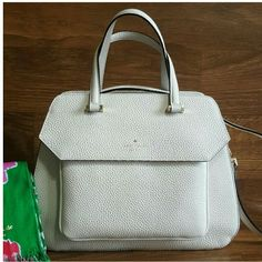 Kate Spade Aubrey Boxwood Road Beautiful bag, trapazoid like shape pebbled leather,gold tone hardware two handles & strap for crossbody.  Zipper closure  one front pocket with flap and magnet closure  Interior features 1 zip pocket 2 open pocket Tag says cream color but looks more white  10 H x 12 w x 5.5 D kate spade Bags Satchels