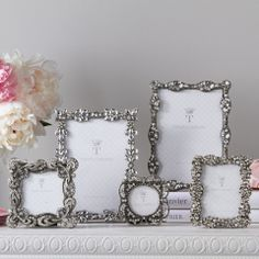 'Crown Jewels' Jeweled Photo Frames .........love the feel of Silver and Jewels with your precious photos on you vanity. Lady Builder Shops