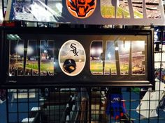 MAN CAVE - Personalized Framed Chicago White Sox Team Logo & US Cellular Field Stadium Large Panoramic Showing In Background With MANCAVE Letters Cut Out & Team Logo In Center-Framed Awesome & Beautiful-Must For Any Fan! Art and More, Davenport, IA http://www.amazon.com/dp/B00KK7THMA/ref=cm_sw_r_pi_dp_OqsEub09MZ3MY