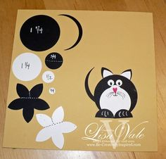Black and white cat punched paper shapes
