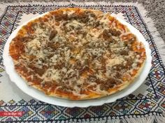 طريقة تحضير بيتزا بدون فرن - http://www.lalamoulati.net/articles/42898.html
