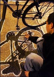 Tracing Shadows - New York Times article on Ellis G., who creates street art from shadows. FUN!  going to do this!