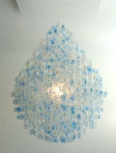 Designer Stuart Haygarth creates chandeliers using the bottoms of plastic water bottles.