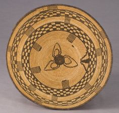 "Native American Yavapai Apache coiled basket    Sign In to see what this sold for  of willow and devil's claw with three rod willow foundation. Decorated with a three-petal rosette in the basin enclosed by a band of negative checkering then a plain band with vertical stripes. The pattern is then repeated toward the darkened rim. 17.25"" Dia. x 4.75""H, Circa - 1900."