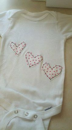 girl onesie with three hearts :)