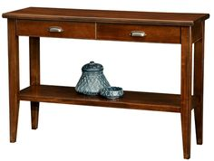 Entryway storage console table with stretcher shelf and two drawers is crafted of solid hardwoods and veneers in a hand applied chocolate cherry finish.
