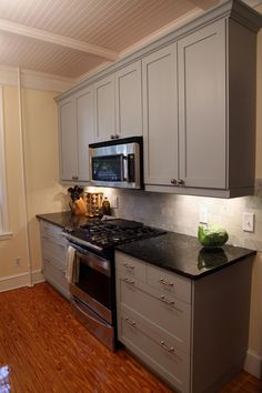 http://www.statelykitsch.com/page/6/  Custom Painted Tidaholm Ikea Kitchen Cabinets awaiting hardware