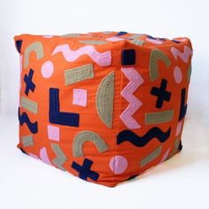 """Embroidered pouf in green, pink, blue, and orange objects print by Dusen Dusen. Cotton. Bean bag filling. Bottom zip. 18x18x18""""."""