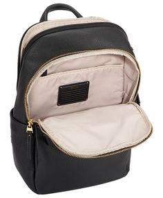 From our bestselling Voyageur collection for notably stylish women on the move comes this new limited-edition backpack in luxurious pebbled leather, elegantly trimmed with sophisticated gold hardware. Thoughtfully designed to accommodate your daily digital essentials and other small accessories in a compactly-chic silhouette, this smaller backpack is ideal for the multitasking commuter who values the convenience of hands-free ease.