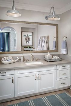 Farmhouse Bathroom with Quartz Countertop. Farmhouse Bathroom with Quartz Countertop Raw Concrete Quartz from Ceasarstone and Barn Lighting. Barn lighting is The Original Warehouse Gooseneck Light from Barn Light Electric Co . #FarmhouseBathroom #Bathroom #QuartzCountertop Tracy Lynn Studio