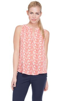 This top features a triangular geo print.