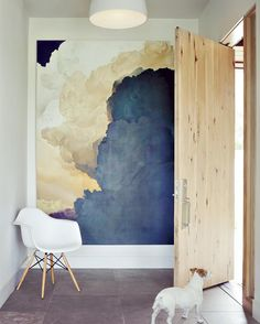 Architect Dale Hubbard designed a Boulder house marked by contemporary forms and rustic materials. For the entry he chose a hickory pivot door by Deines Custom Door and Kansas limestoneto match the exterior for the floor. The large-scale painting is by Ian Fisher and the pendant is by Artemide. #lisbonfinest #realestate #lisbon #lisboa #лиссабон #португалия #portugal #finestproperties #luxury #deco #недвижимость #интерьер #investment #homedesign #travel #дом #homedecoration #homedesign #home…