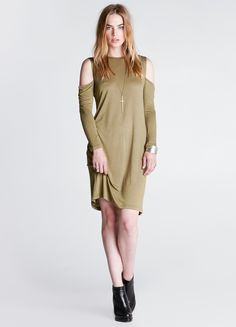 """Long sleeve midi dress featuring cold shoulders.  By Cheap Monday 100% Viscose 37"""" length 36"""" bust 36"""" waist Model is wearing size XS"""