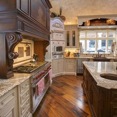 Don't like the cabinet style, but I love the diagonal hardwood floors and wide planks.