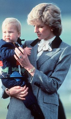 Princess Diana: Only Diana (here, with baby William in 1983), could transform a conservative grey coat into a must-have fashion statement. (Photo by Anwar Hussein/Getty Images)