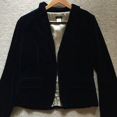 J Crew deep navy velvet blazer Gorgeous deep navy blue velvet blazer by J Crew.  Lined with satin material and beautiful magenta and blue striped piping.  Hook eye closure at front.  No back vent.  Pristine condition. Size 8 but made to have a tailored fit. J. Crew Jackets & Coats Blazers