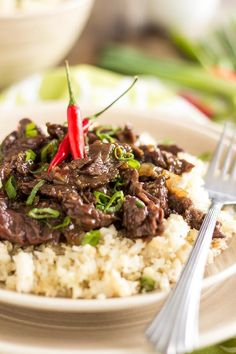 Mongolian Beef over Cauliflower Rice - A recipe right out of The Paleo Kitchen by Juli Bauer and George Bryant
