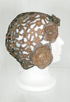 Metallic-gold lame floral applique cut-out cloche hat, 1920's.