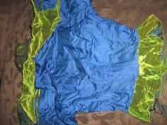 Awesome bright blue 1890s bodice with lime green velvet trim, back.